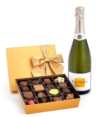Veuve Clicquot Demi-Sec & 19-pc Godiva Chocolates - Regular Demi-Sec, a slightly sweet style of Champagne, is at its best when served with desserts. Veuve Clicquot Demi-Sec, marked by fresh peach, nectarine and orange blossom, pairs beautifully with Godiva's assorted deep dark chocolates, smooth milks, velvety ganaches, classic truffles and pralines. Truly irresistible! Includes:  Veuve Clicquot Demi-Sec Champagne (750 ML)  Godiva 19-piece Assorted Chocolates  Gold Gift Box