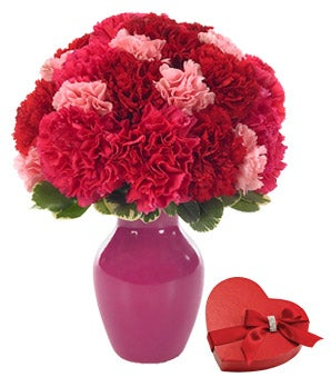Red carnations, pink carnations and a box of chocolate gift
