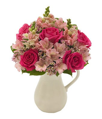 Pink roses and alstroemeria in pitcher vase