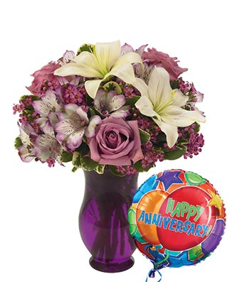 Purple roses and white lilies delivered with anniversary balloon