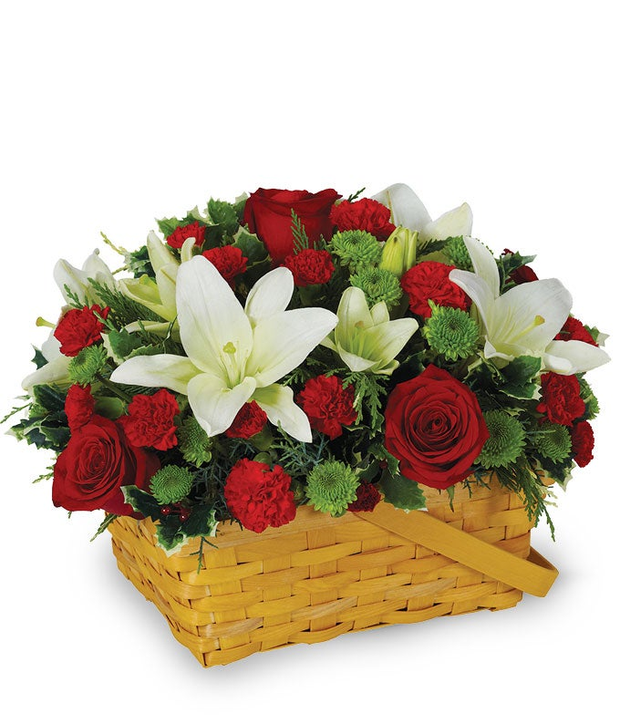 Red roses, white lilies and carnations in a basket for Christmas
