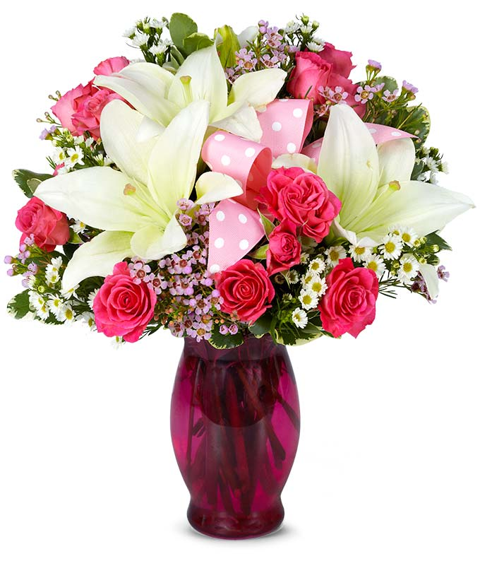Pink spray roses, white lilies and pink wax flower