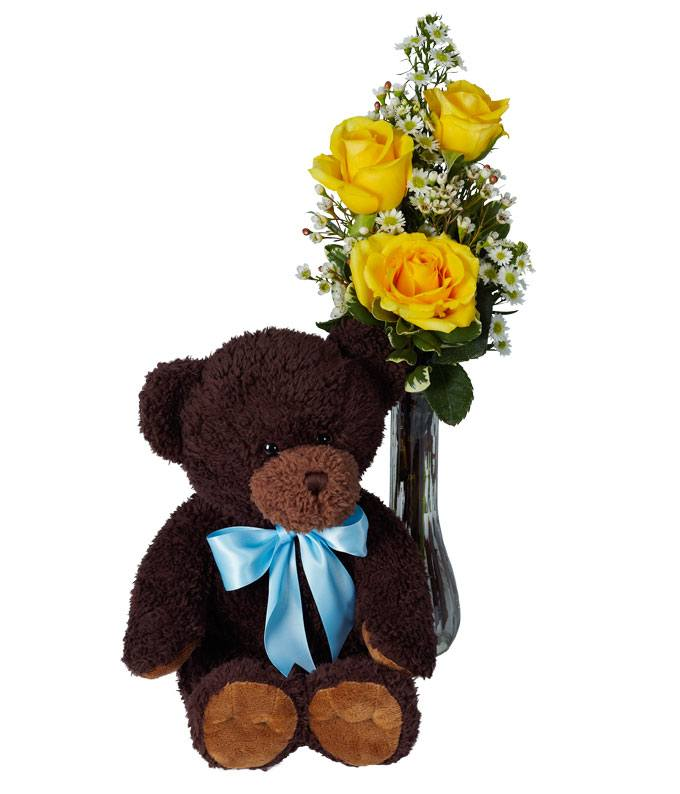 Yellow roses in vase with teddy bear
