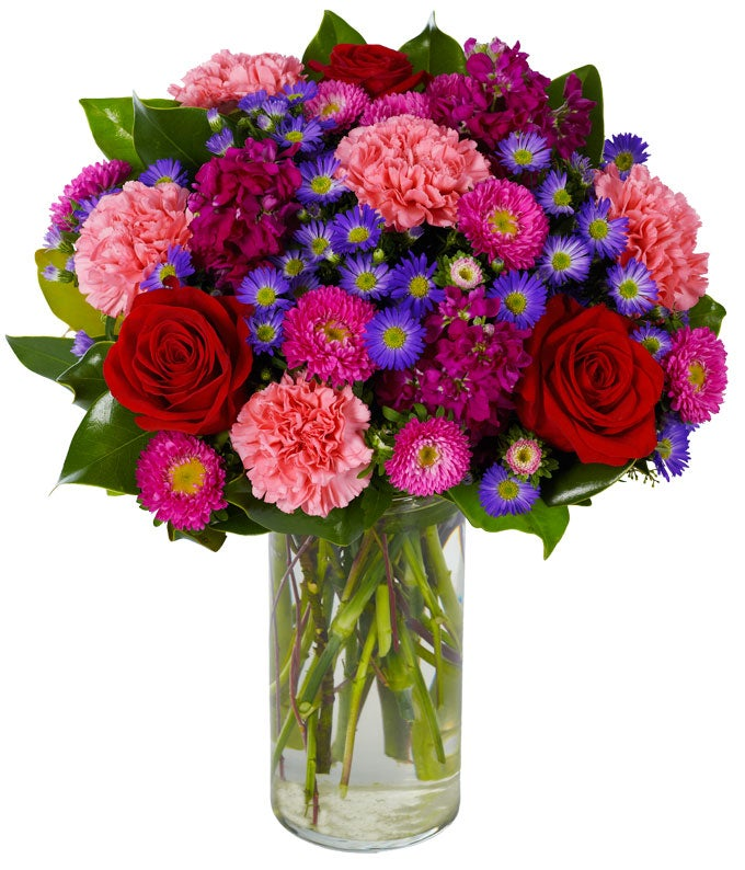 Red roses, pink carnations and hot pink Matsumoto asters in vase