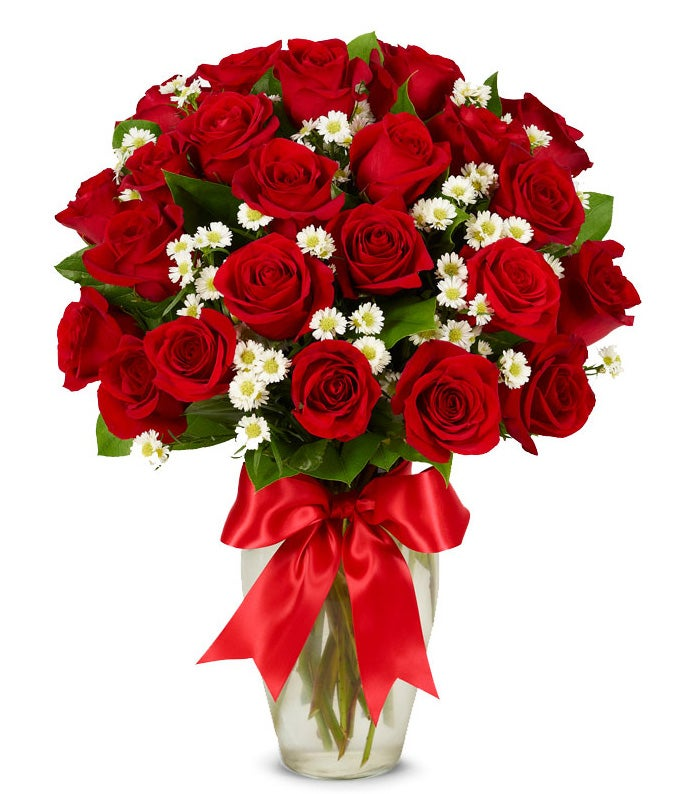 Two dozen long stem red roses delivered by a florist