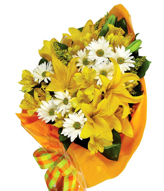 Yellow lilies and white daisies wrapped in floral paper with ribbon