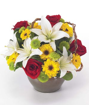 Red roses, white lilies and curly willow in circular vase