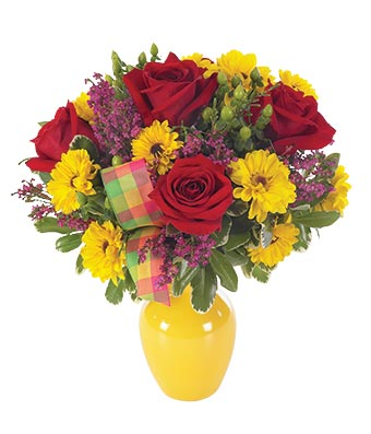 Red roses, yellow daisies and greens in yellow vase