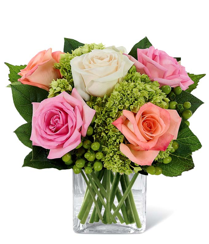 Flowers - Rose & Hydrangea Garden Bouquet - Regular Two of nature's most radiant botanical creations...roses and hydrangea...blend together in harmonious beauty with hypericum in this stunning bouquet set in a pretty container adorned with floral designs. A great gift for Mother's Day, or to celebrate the warmth and wonder of Spring. Includes:  Pink Roses  Cream Roses Peach Roses  Green Mini Hydrangea  Square Pot Cover