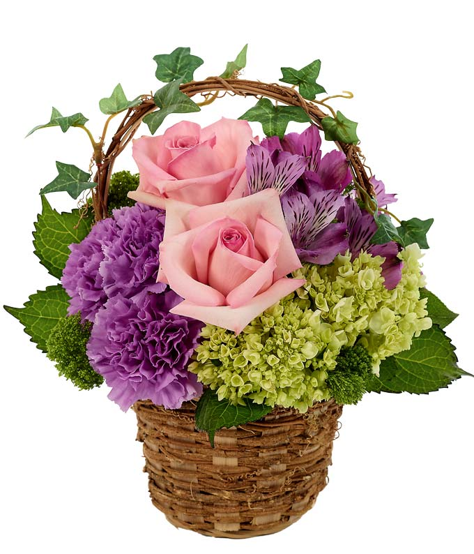 Flowers - Garden Ivy Basket - Regular Can't you just feel yourself meandering about a country garden surrounded by the sights and scents of beautiful blooms? This arrangement evokes those thoughts, featuring pink roses, mini hydrangea, purple carnations, purple alstroemeria and green trick in a woven basket with ivy accents. Includes:  Pink Roses  Mini Green Hydrangea  Purple Carnations  Purple Alstroemeria  Woven Floral Basket