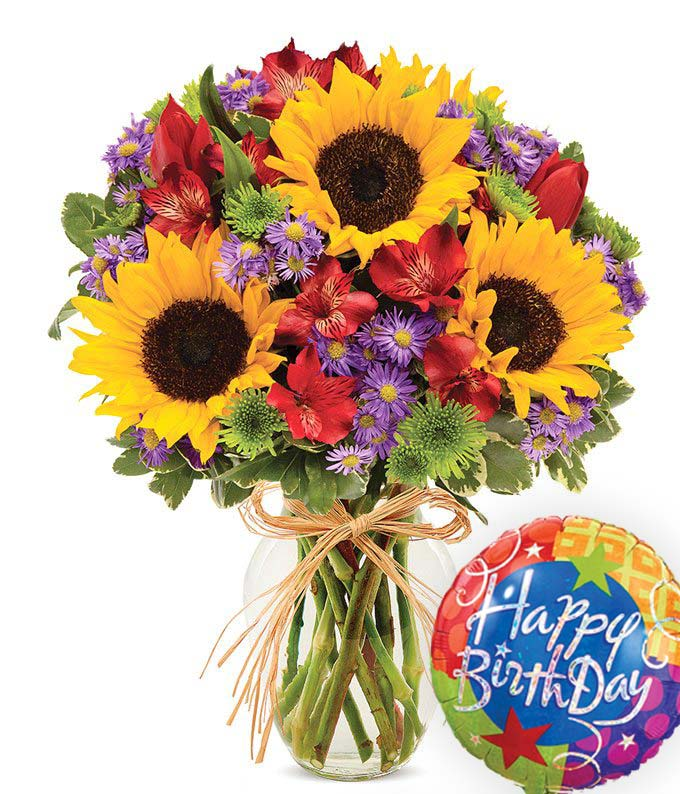 Birthday Flowers - Bountiful Garden Birthday Bouquet - Regular Celebrate a birthday with a flower bouquet inspired by the essence of Europe, paired with a Happy Birthday balloon. The European Garden Bouquet is arranged by a local florist with alstroemeria, button poms, monte casino, sunflowers and tulips in an elegant clear glass vase. Measures 12 H by 10 L. Includes:  Happy Birthday Balloon  Sunflowers Tulips Alstromeria  Local Florist Delivery