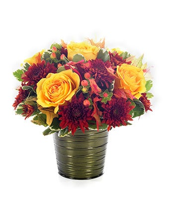 Flowers - Autumn Garden Blooms - Regular With its breathtaking combination of yellow roses, orange hypericum and bronze mums expertly brought together in an iridescent brown potcover container, this arrangement immediately evokes the beauty of autumn in Europe. Measures 10 H by 10 L. Includes:  Yellow Roses  Orange Hypericum  Bronze Mums  Iridescent Brown Potcover Flower Delivery Available Today