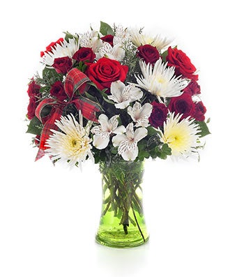 Flowers - Winter European Garden Bouquet - Regular No matter how cold a winter's day may get, you'll express the warmest wishes with this extraordinary Christmas arrangement featuring the unmatched beauty of holiday red roses, white alstroemeria, white mums and white spray roses in a green gathering vase. Measures 18 H by 15 L. Includes: Red Roses  White Alstroemeria  White Spider Mums  Holiday Ribbon  Glass Vase