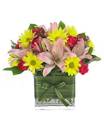 Home is Where the Heart Is - Regular Brighten your place and theirs, instantly, with a burst of color brought to life by carnations, button mums and Asiatic lilies in a handsome rectangular glass vase. Same day flower delivery available. Measures 16 H by 12 L. Includes: Pink & Yellow Carnations  Button Mums  Pink Asiatic Lilies  Rectangle Glass Vase  Personalized Card Included