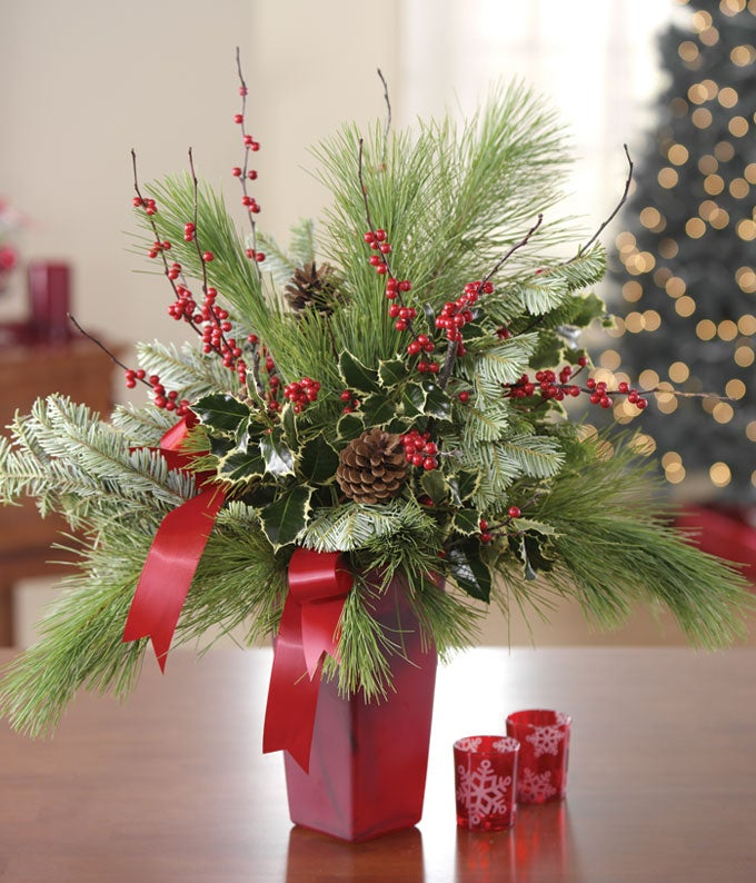 Christmas arrangement with hypericum berries and evergreen