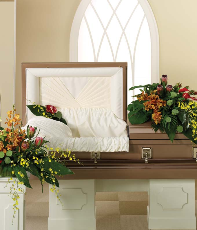 Half casket spray of red, yellow, orange & green orchids