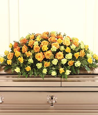 Orange roses, yellow roses and green roses in sympathy casket spray