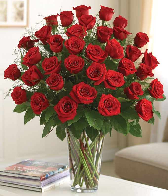 Luxury flower bouquet with three dozen red roses