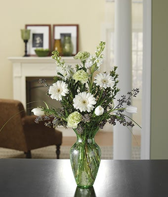 Flower arrangement with white tulips, white daisies and green carnations