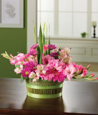 Flower basket with pink gerbera daisies, pink alstroemeria and gladiolus