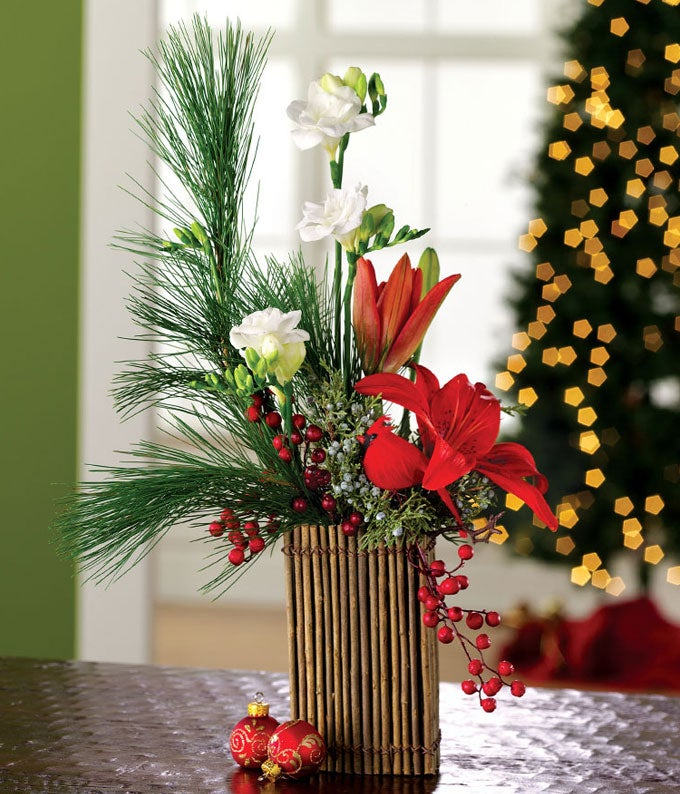 Holiday floral bouquet with lilies, freesia and pine