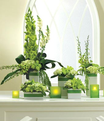 Green rose, orchids and hydrangea alter arrangement