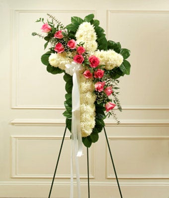 White mums and pink roses in a florist delivered standing spray