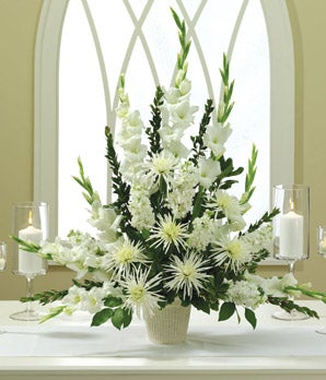 White flowers alter arrangement with mums and gladioli