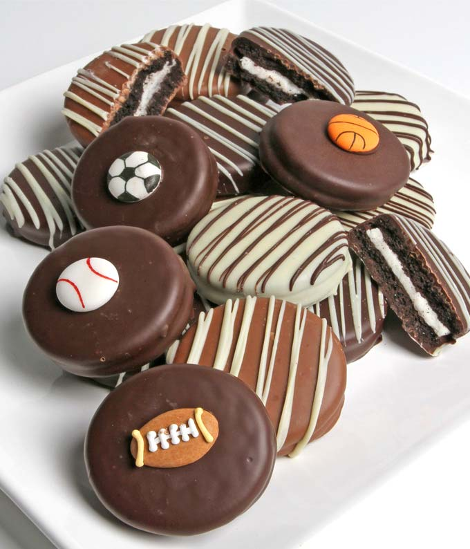Sports Belgian Chocolate Covered OREOS - 12 Pieces - Regular Play BALL! This delicious gift is a great way to celebrate the sports fan in your life. Delicious OREOS are dipped in Belgian Chocoalte and then decorated with baseball, football, basketball, and soccer edible decorations. This is a great gift for the athlete in your family. Chocolate contains milk and soy. This product is made in a facility that manufactures products containing one or more of the following ingredients: peanuts, tree nuts, soybeans milk, eggs and wheat. Includes:  Twelve Oreo Cookies  Topped with Sport's Candies Dipped in White, Milk & Dark Chocolate  Resuable Cooler