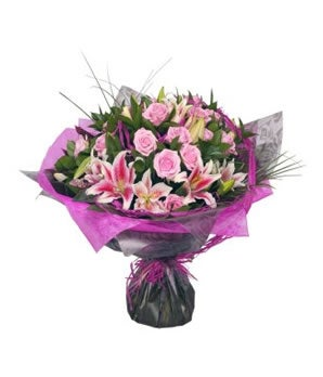 Pink roses, Pink lilies and greens in hand tied bouquet