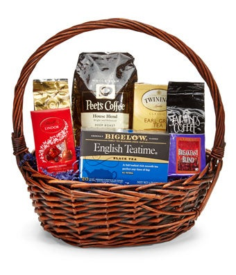 Coffee and Tea Treats - Regular The is the perfect good morning wake up call, a basket filled with delicious coffee's, teas, and snacks is sure to bring them joy and comfort. Perfectly assorted in a delightful basket this gift is perfect for any occasion, and is sure to provide your recipient with many wonderful mornings and evenings for the time to come! Please note that the assortment of coffee, tea, and snacks may vary in each coffee gift basket. Includes:  Coffee Bean Variety  Tea Variety  Gourmet Chocolate Treat  Woven Basket