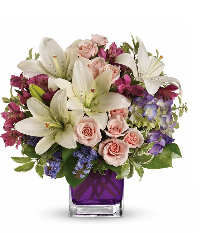 Flowers - Garden Romance - Regular Va-va-bloom! This stunning arrangement of purple hydrangea, light pink spray roses and white asiatic lilies is perfectly presented in our violet cube. Includes:  Purple Hydrangea  Light Pink Spray Roses  White Asiatic Lilies  Pink Alstroemeria  Purple Square Glass Vase