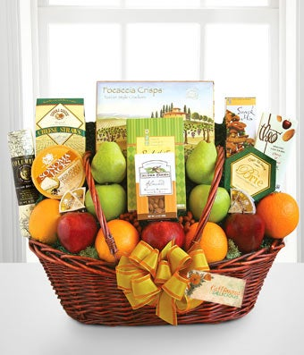 Gift Baskets - Share the Health - Regular Healthy wishes abound with this large array of fresh fruits and treats to share with the entire group. The basket is packed with crispy apples and pears, juicy oranges, cheese, cookies, focaccia crisps, Columbus salami, cheese straws, almonds, dried fruit, and Ghirardelli chocolate. Includes:  Fresh Apples  Pears & Oranges  Cookies & Focaccia Crisps  Columbus Salami  Cheese Straws  Almonds & Dried Fruit  Ghirardelli Chocolate