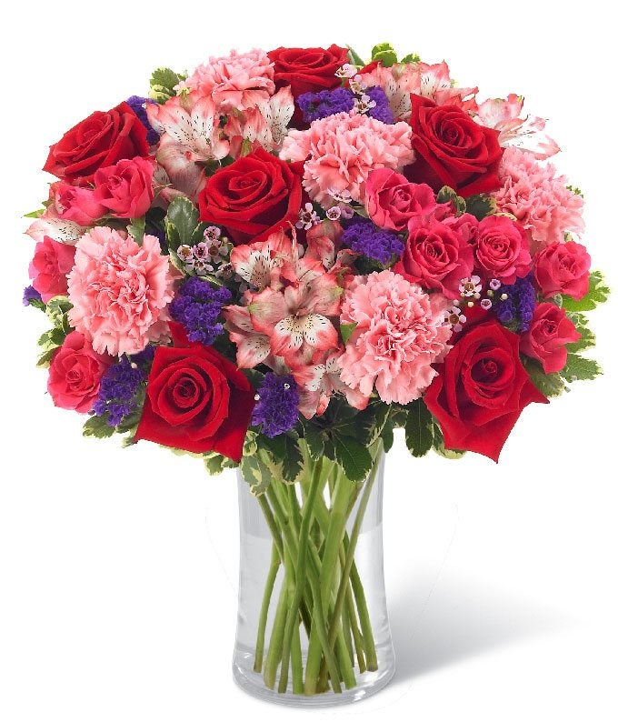 Red roses delivered with pink carnations and alstroemeria