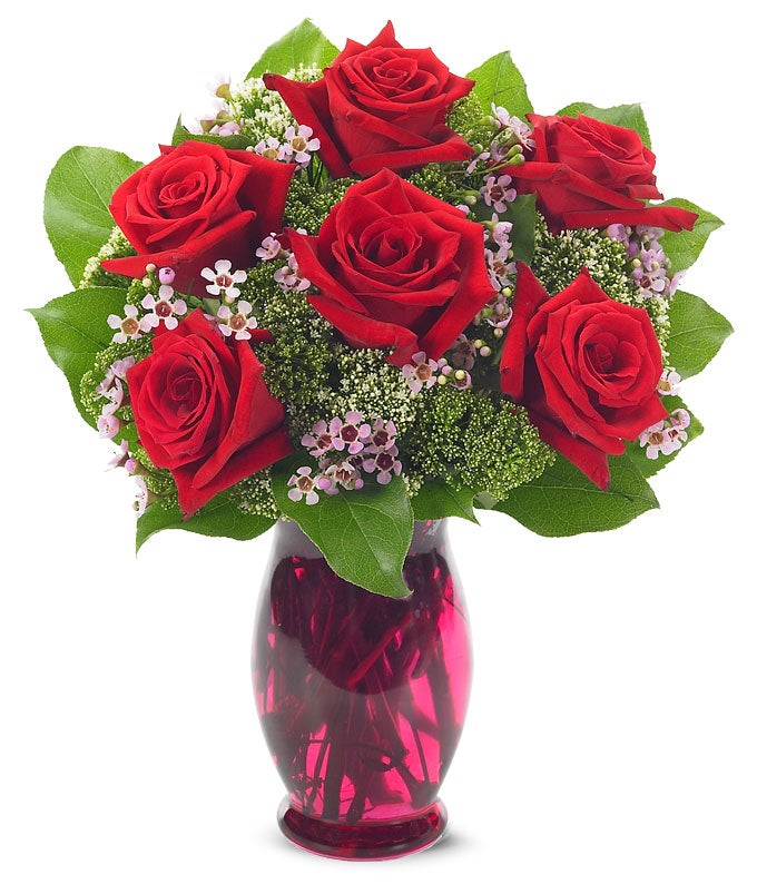 Flower arrangement with red roses in colorful vase