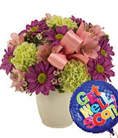 Pink alstroemeria and purple daisies in mug with get well balloon