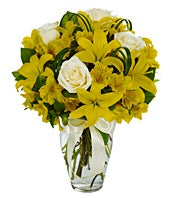 Yellow Asiatic lilies, white roses and yellow alstroemeria bouquet
