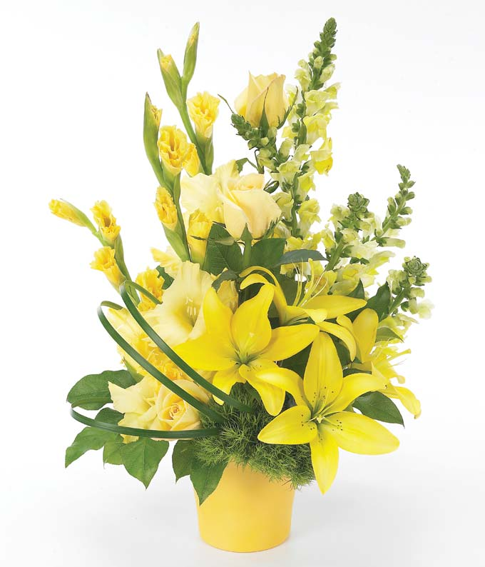 Yellow and green roses and lilies in yellow vase
