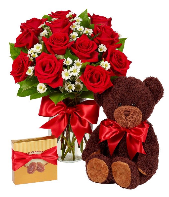 One Dozen red roses with a teddy bear and chocolates