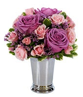 Purple roses and mini pink roses in a silver julep cup