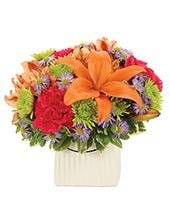 Orange lilies, red carnations and green pom bouquet