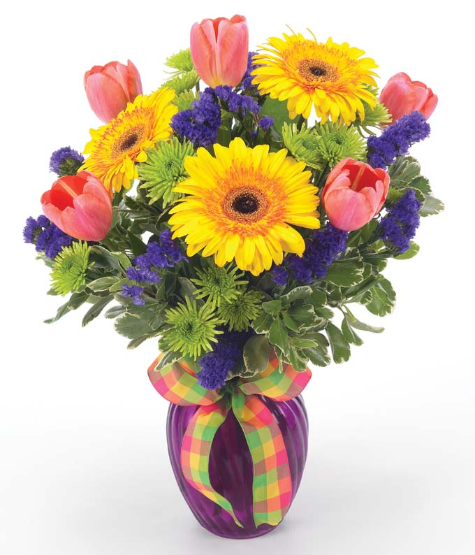 Flower Delivery in bright colors in purple vase