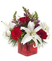 Modern holiday bouquet with roses in a square vase