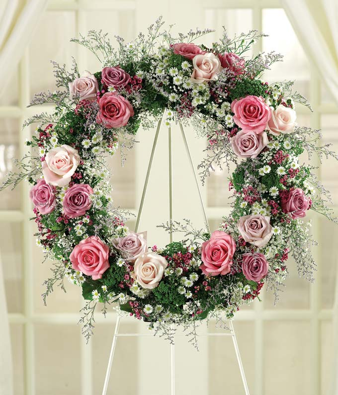 Pink roses, purple roses and white roses in funeral wreath