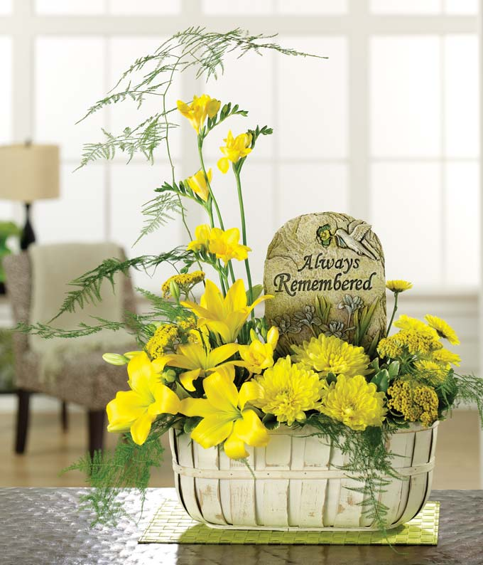 Sympathy bouquet with yellow lilies and mums