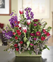 Hot pink spray roses, white tulips and pink asters in a basket