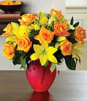 One dozen orange roses and yellow lilies
