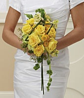Bridal bouquet of yellow roses and carnations