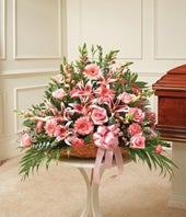 Pink fireside basket with roses, carnations and lilies