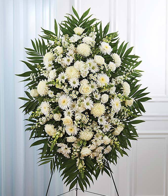 Standing spray with white roses, football mums and snapdragons